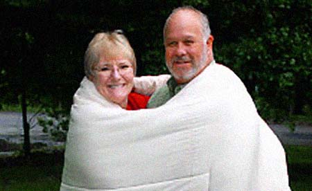 The blanket-wrapped couple in Uzzle's iconic Woodstock pix, Nick and Bobbi Ercoline of Bethel, NY, are still together 40 years down the Pike! - Click Here To Read NY Daily News' Jim Farber story!
